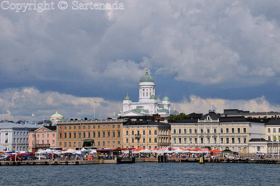 Helsinki skyline seen from sea. Helsinki market square at foreground.