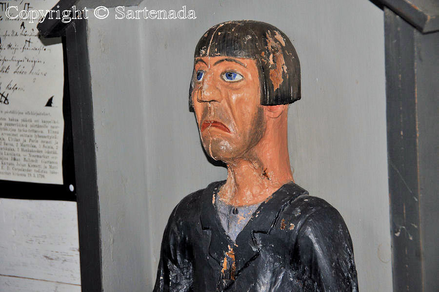 Historic wooden Poor Man statue in Pomarkku, Finland