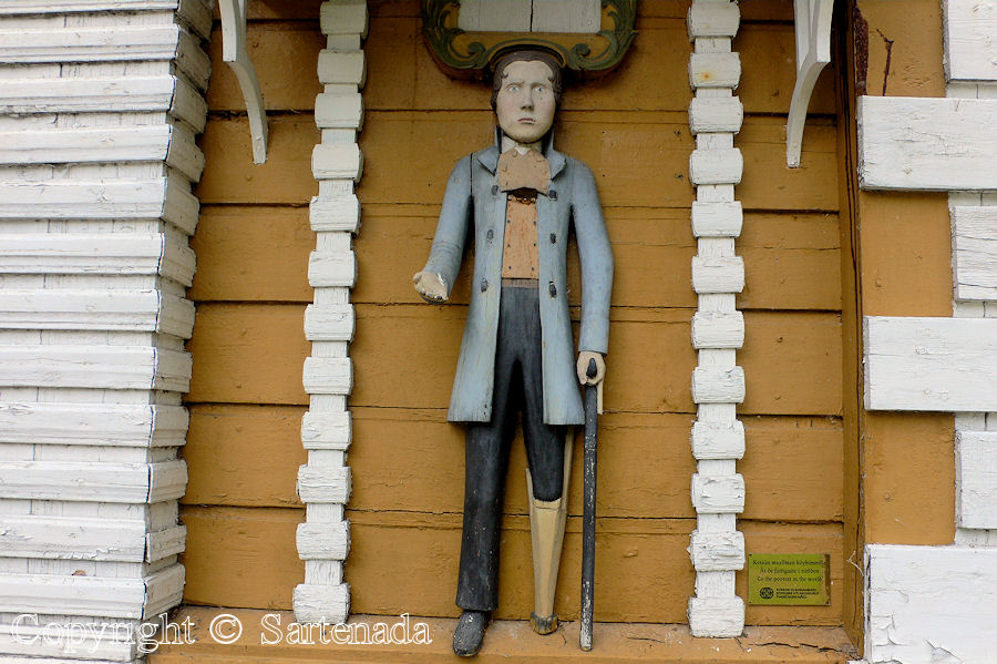 Historic wooden Poor Man statue in Kuortane, Finland.