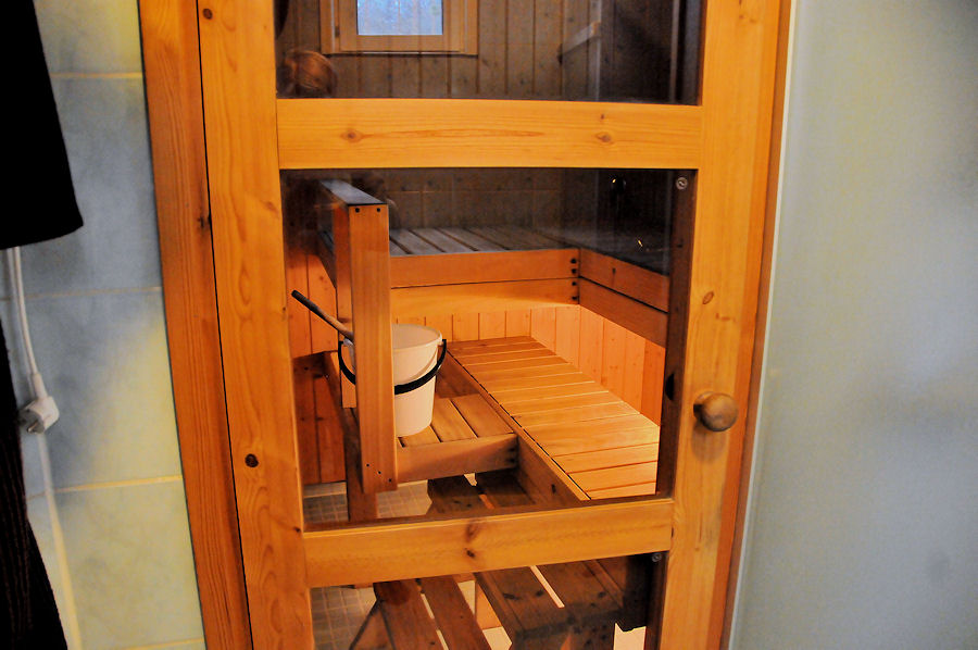 Sauna seen thru the door of shower room