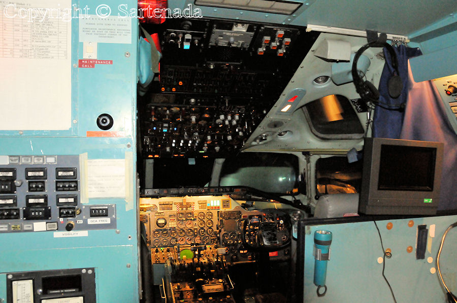 Cockpit of DC-9 seen from the entrance. At background the view of flight deck