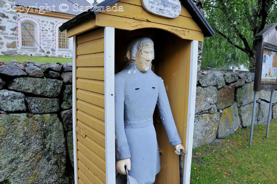 Munsala - Poorman statues. Wooden beggar statues. Finnish pauper sculptures