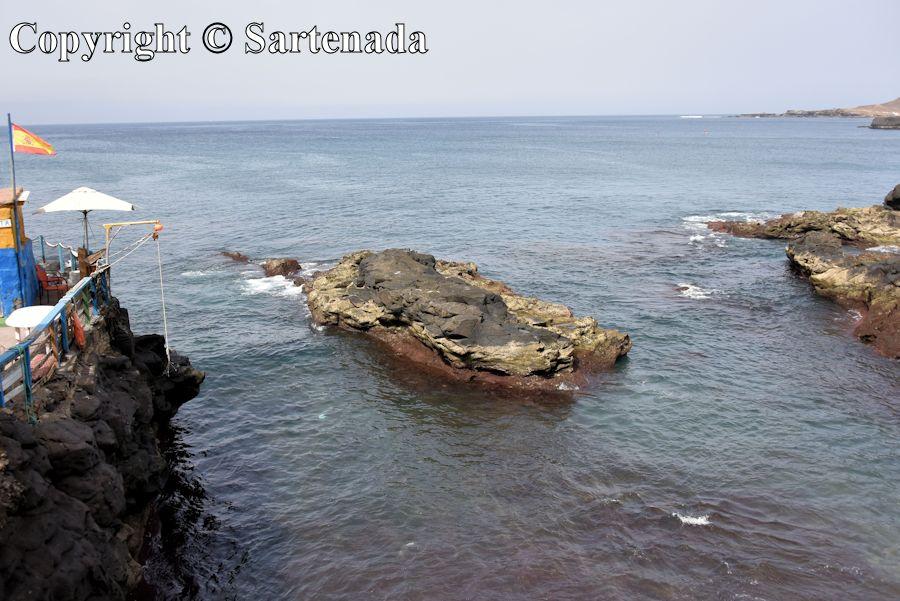 25. Lava rock in the sea