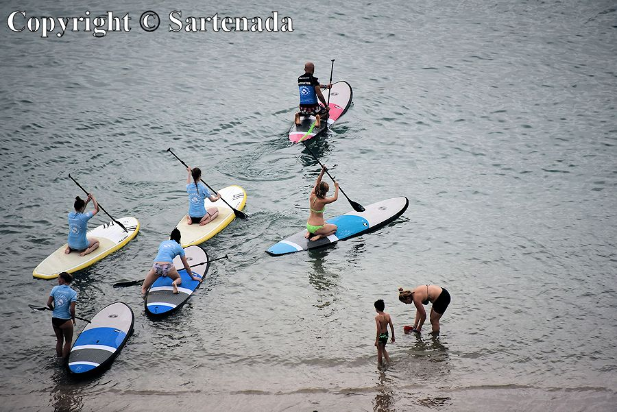 42. These stand up paddlers after training go for the first time to go to sea. They were playing all the long day